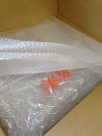 精密機器のケースカバー、納品時と同じように再梱包します